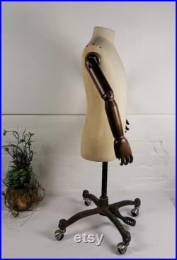 Vintage Mannequin with wooden arms on rolling base. Tailor's Dummy.