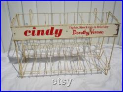 Vintage Stocking Display Rack with Unused stockings.